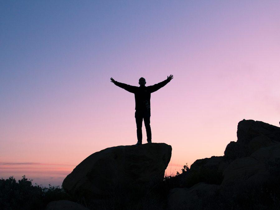 A Confident Man on a Rock