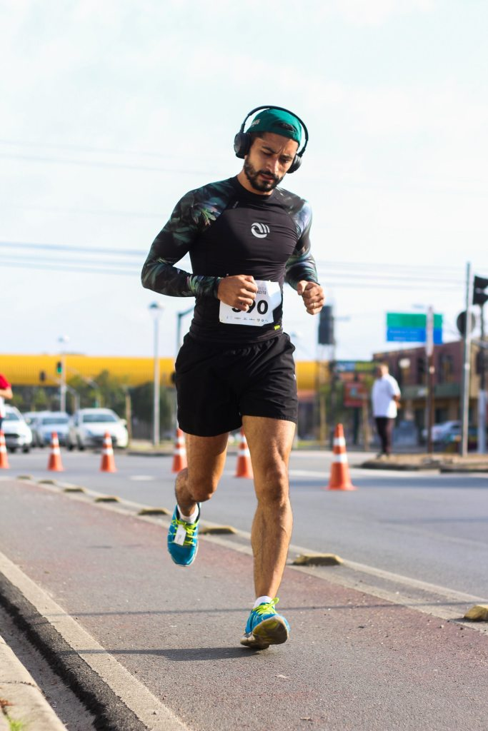A man building confidence by running a race
