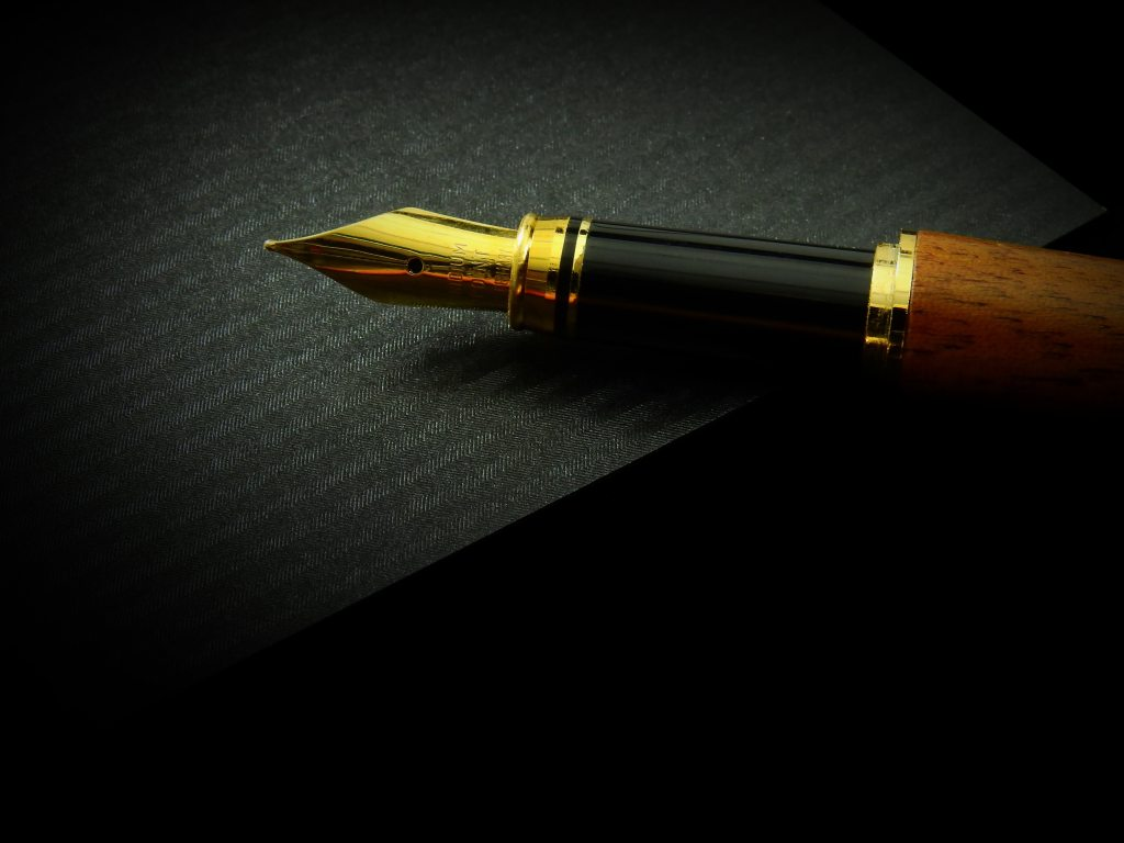 A person writing with a nice pen.