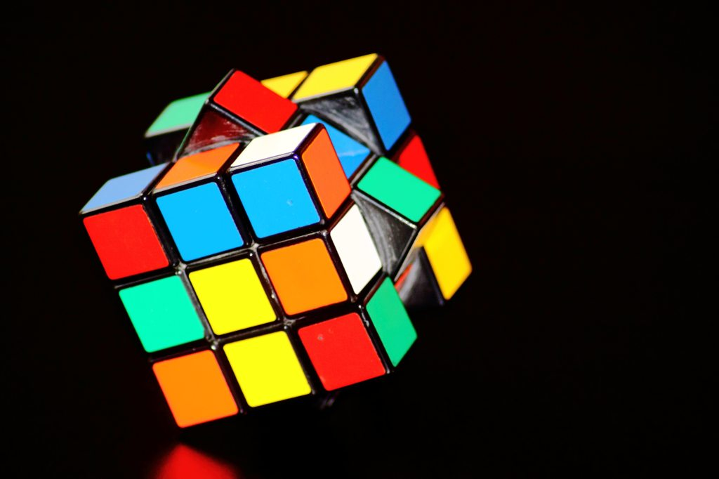 A person solving a rubiks cube